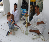 A young visitor tries the shisha